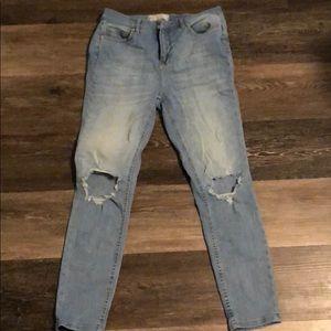 Free People busted knee skinny jeans.